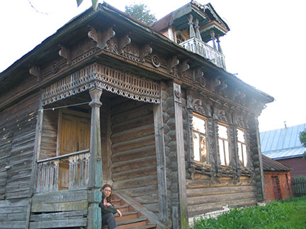 The native house of Nikolai Kuzmin in Talynskoye, not far from Nizhny Novgorod, in 2004 with his daughter Luba sitting on the porch.