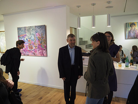 Nikolai Kuzmin is present, discussing with the visitors