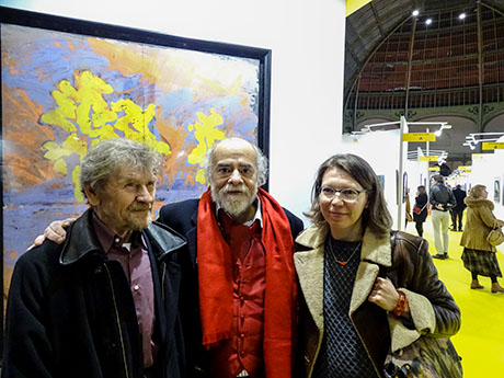 Nikolai Kuzmin with his fellow artist Daniel Gallais and Liubov Kuzmina in front of his work presented in Grand Palais